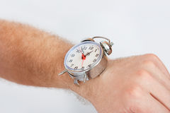Hand with Alarm clocks Royalty Free Stock Photography