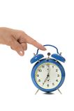 Hand and alarm Royalty Free Stock Photos
