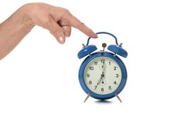 Hand and alarm Stock Image