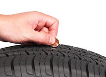 Hand with american cent coin check tire condition  Royalty Free Stock Photography
