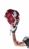 The hand of american football player with helmet on white background. The hand of caucasian fitness man as american football player with helmet  on white Royalty Free Stock Images