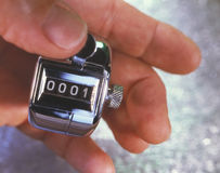 Hand with analog counter at number one Royalty Free Stock Image