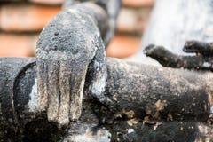 Hand of an ancient Buddha image Stock Image