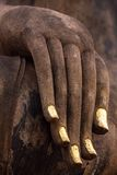 Hand of an ancient Buddha statue Stock Images
