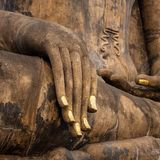 Hand of an ancient Buddha statue Stock Image