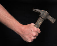 Hand and Ancient Hammer Royalty Free Stock Photos