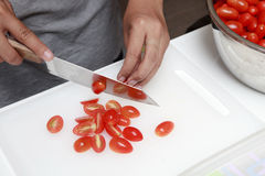 Free Hand And Knives Slicing Red Tomato Royalty Free Stock Photo - 26770675