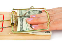 Hand And Mousetrap With Money Royalty Free Stock Image
