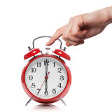 Hand And Red Old Style Alarm Clock Isolated Royalty Free Stock Photos