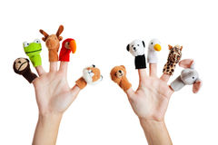 Hand with animal puppets. Female hand wearing 10 finger puppets stock image