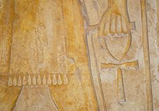Hand with Ankh 1. Egyptian inscription of the Ankh symbol. Detail of a temple wall Royalty Free Stock Image