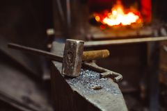 Tools in the forge. Hand anvil. hummers all blacksmith tools in forge royalty free stock photos