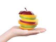 In hand appel en sinaasappel Stock Foto's