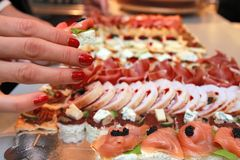 Hand and appetizer Royalty Free Stock Photography