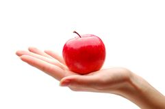 Hand with apple. On a white background Stock Photos