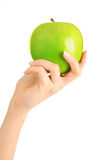 Hand with apple Royalty Free Stock Photo