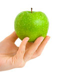 Hand with apple Royalty Free Stock Images