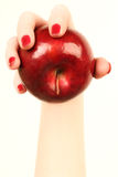 Hand and apple. Ripe apple in the woman hand Stock Images