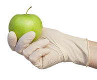 Hand with apple Stock Images