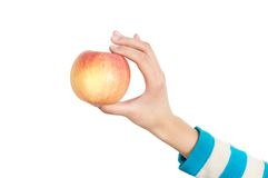 Hand and apple Stock Image