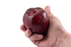 Hand with an apple. Red apple in a hand on a white background Stock Photos