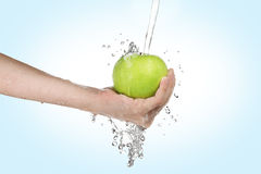 Hand with apple Stock Image