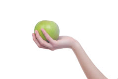 Hand with apple isolated on white stock photos