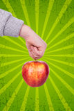 Hand and apple Royalty Free Stock Images