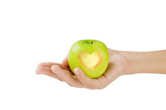 Green apple with heart shape Royalty Free Stock Photos