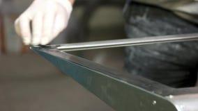 Hand applies primer on steel. stock footage