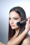 Hand applying make up Royalty Free Stock Image
