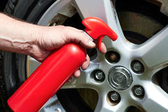 Hand applying polish car wheel Stock Image