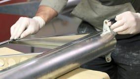 Hand applying primer on steel. stock video