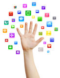 Hand with apps. Human hand with variety of colorful mobile applications, isolated on white, clipping path Stock Photos