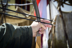 Hand of an archer aiming two arrows, Italy. Royalty Free Stock Images