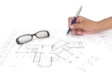 Hand with Architect's plans. House architecture plan on paper Stock Image