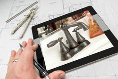Hand of Architect on Computer Tablet Showing Bathroom Details Ov Stock Photo