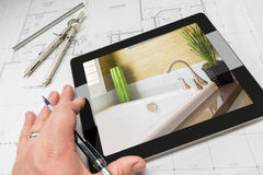 Hand of Architect on Computer Tablet Showing Bathroom Details Ov Royalty Free Stock Photos