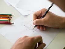 Architect design and drawing plan house. Hand of architect design and drawing plan house Stock Photography