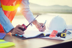 Hand of architect drawing on architectural project royalty free stock image