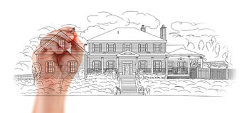 Hand of Architect Drawing Detail of Custom House Design. Architect Drawing Detail of Custom House Design Stock Photo