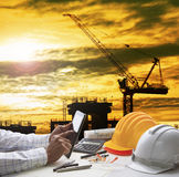 Hand of architect working on computer tablet  with construction Stock Photos