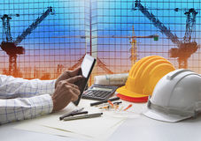Hand of architect working on table with tablet computer and work Stock Photos
