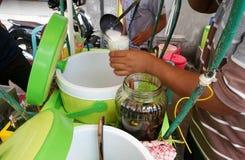Free Hand Are Mixing Cendol With Coconut Milk , Indonesia Desserts Called Cendol Stock Photo - 174927890