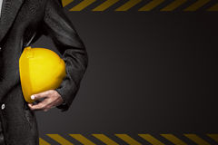 Hand or arm of engineer hold yellow plastic helmet for worker Stock Images
