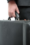 Hand and arm holding briefcase Stock Photo