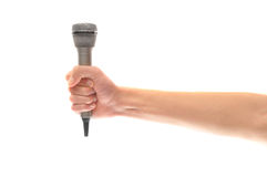 Hand and arm holding microphone isolated on white. A hand gripping a silver microphone isolated on white background with lots of copyspace royalty free stock photos