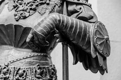 Hand in armour of the medieval knight statue.  Stock Photos