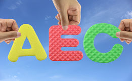 Hand arrange alphabet AEC of acronym ASEAN Economic Community. Hand arrange alphabet AEC of acronym ASEAN Economic Community in trade and investment royalty free stock images