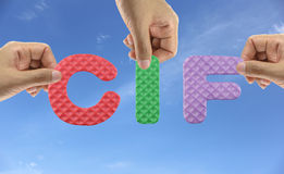 Hand arrange alphabet CIF of acronym Cost Insurance and Freight. Stock Image